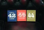 3_brochures_on_sofa